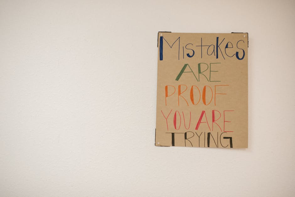 A sign hanging on a wall